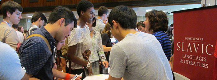 Andy Zhang and Clare Cavanagh greet undergrads at the Majors Fair