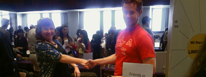 Clare Cavanagh handshake with student at fair